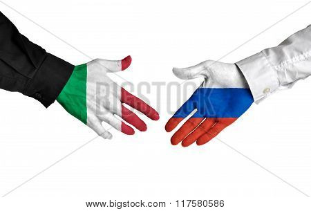 Italy and Russia leaders shaking hands on a deal agreement