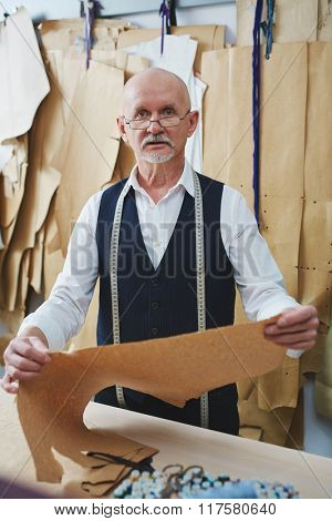 Tailor with paper pattern