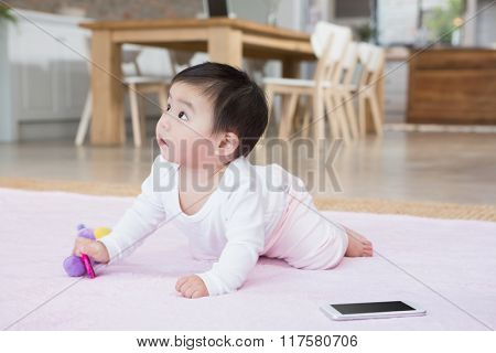 Cute baby on the carpet looking up