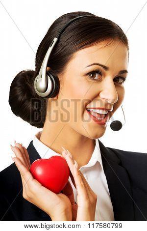 Call center woman holding heart model