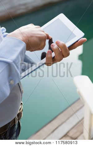 Close up of man using tablet