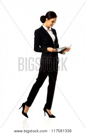Happy businesswoman reading her notes