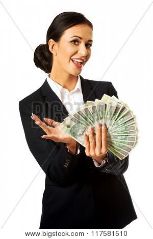 Businesswoman holding a clip of polish money