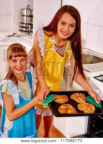 Mother and daughter bake cookies together  kitchen  at home.
