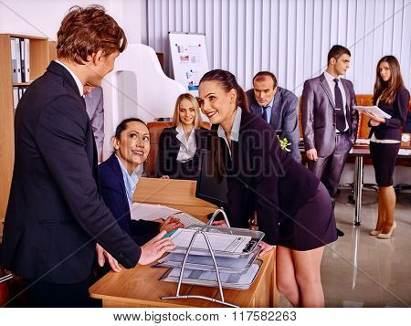 Happy group business people in office. Man speaking with women.