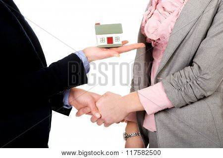 Businesswoman giving a house to her partner.