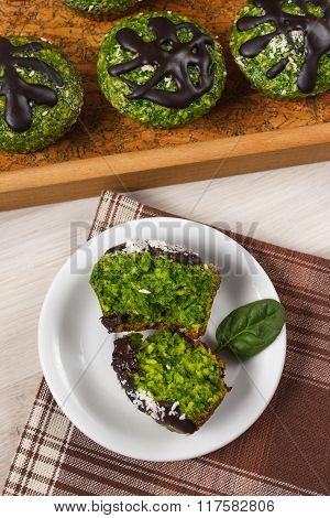 Fresh Muffins With Spinach, Desiccated Coconut And Chocolate Glaze, Delicious Healthy Dessert