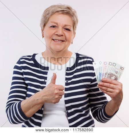 Happy Senior Female Holding Polish Currency Money And Showing Thumbs Up, Financial Security In Old A
