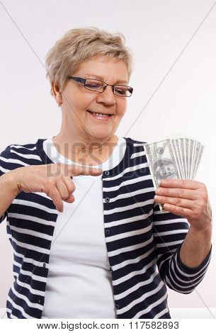 Happy Senior Female Showing Currencies Dollar, Concept Of Financial Security In Old Age