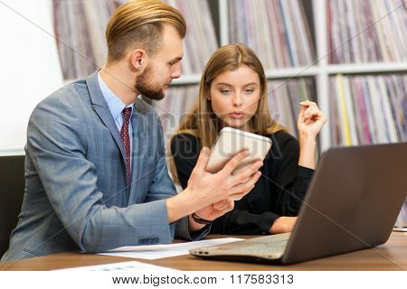 Image of two successful business partners working at meeting in office