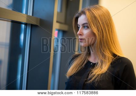 Woman looking out of the window