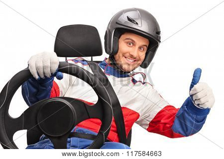 Joyful car racer holding a steering wheel and giving a thumb up isolated on white background