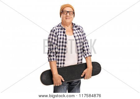 Studio shot of a senior skateboarder looking at the camera isolated on white background