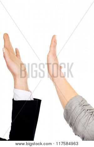 Two businesswomen giving a high five.