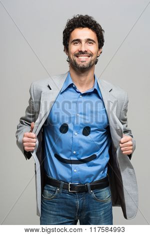 Happy business concept, smiley on a shirt