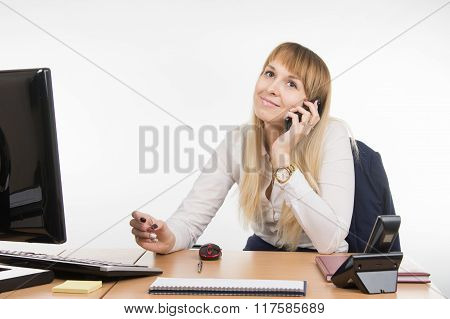 Office Specialist Talking On A Cell Phone In The Workplace