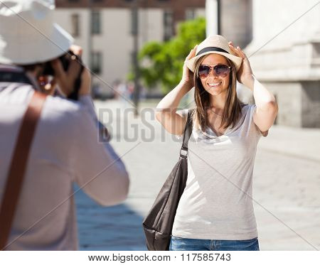 Photographer taking an outdoor portrait of his girlfriend