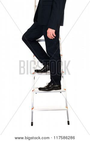 Close up male legs climbing ladder