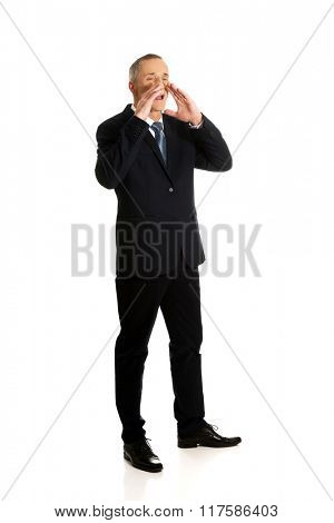 Full length businessman calling for someone