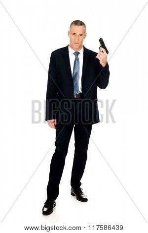 Full length serious mafia agent with handgun