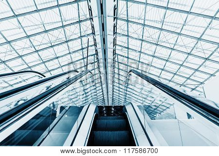 Structured Glass Roof And Escalators Leading To The Hall.