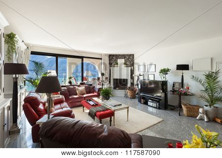Architecture, interior of a modern house, comfortable living room with leather divans