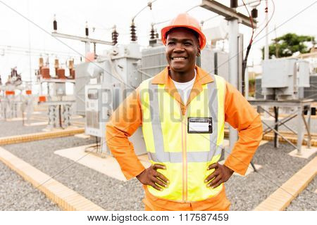 happy african american technician looking away in substation