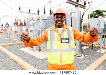 cheerful afro american technician giving thumbs up in substation