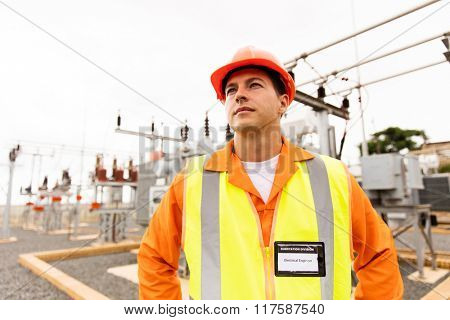 thoughtful male engineer looking up in substation