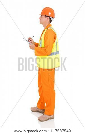 side view of young male electrician writing on clipboard