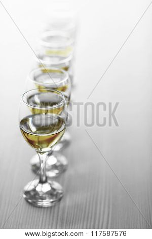 Row of wineglasses on wooden blurred background