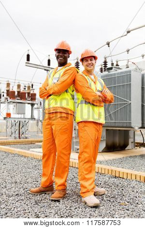 multiracial electrical co-workers in electric substation
