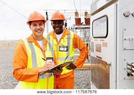 portrait of male engineers working together in electrical substation