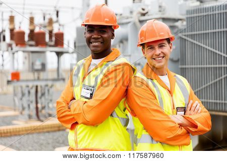 professional electrical engineers with arms crossed in power plant