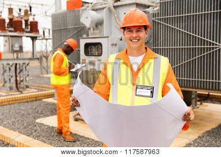 happy industrial engineer working in electric substation