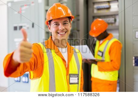 cheerful control room electrical engineer thumb up