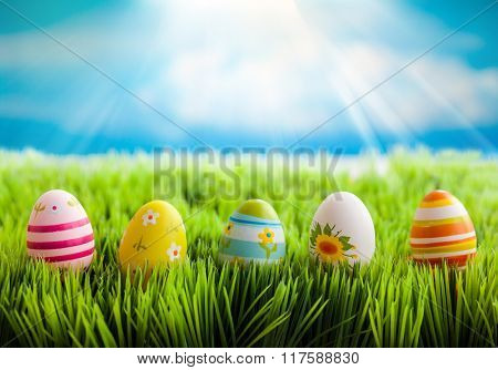 Colorful easter eggs on the green grass