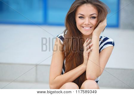 Young smiling woman outdoors portrait.