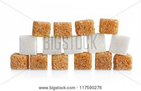 Pile of brown and white sugar cubes isolated on white background