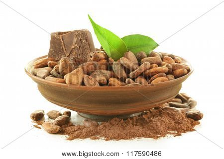 Bowl with aromatic cocoa beans and chocolate isolated on white background, close up