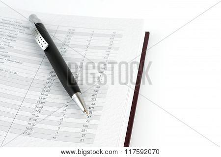Black Ballpoint Pen On A Page Calendar.