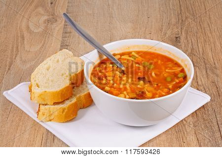 Vegetarian minestrone soup with bread.