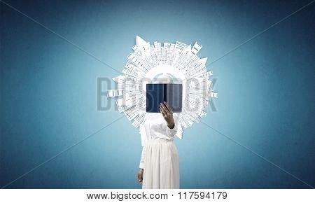 Woman hiding face behind book