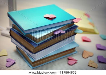 Heart bookmarks for books on wooden table closeup