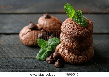 Chocolate chip cookie with chocolate pieces and mint, closeup