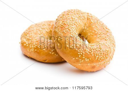 tasty bagel with sesame seed on white background