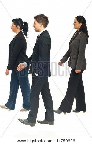 Profile Of Business People Walking