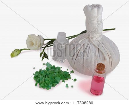 spa treatment with oil and salts and rose and herbal compress