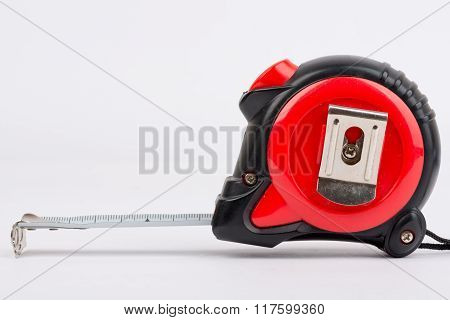 Construction measuring tape close up. On a white background