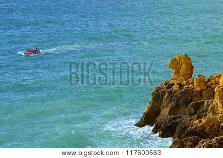 Tourists enjoying the view of the Camels head spectacular rock formations from a boat